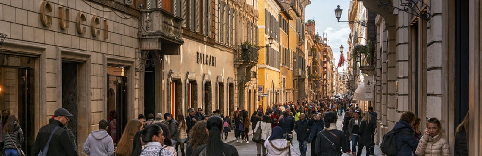 Rome, italy, february 2017: people walking along the elegant shopping avenue Via di Condotti in Rome, Italy